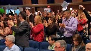 John King met protests at Mineola HS forum